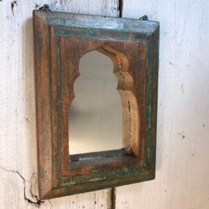 green wooden mirror