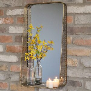 gold mirror with shelf