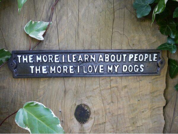 cast iron dog sign